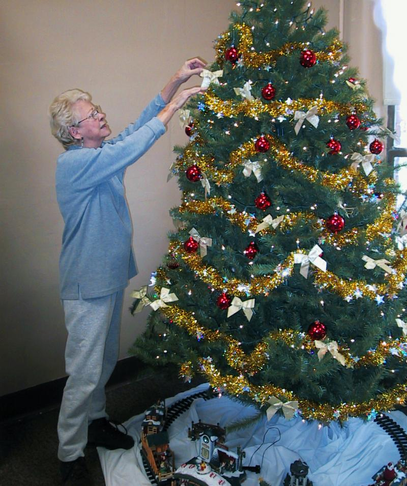 Katie decorating tree for Christmas Mart