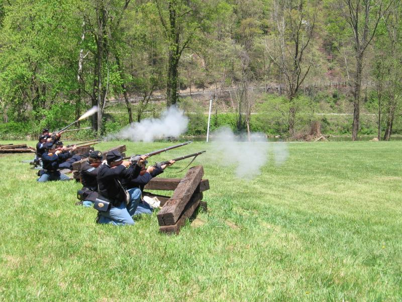 Union Troops behind crossties firing at Confederate Calvary
